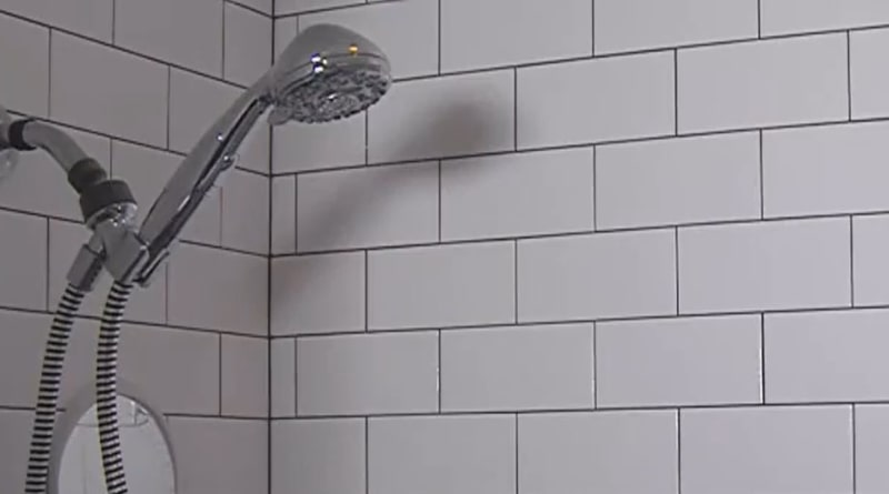 How does a low flow shower head work